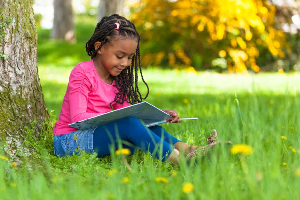 summer reading - girl reading on the grass